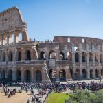 Sunny day at the Rome Coloseum with lots of tourists
