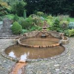 two overlapping circular pools surrounded by paved stone area