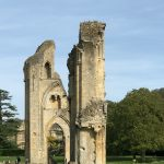 wall and archway of ruined remains of Glastonbury Abbey