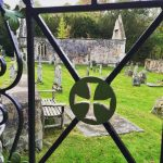 knights templar cross in iron overlooking cemetery London England