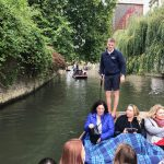 guests in a punt floating on the River Cam at Cambridge
