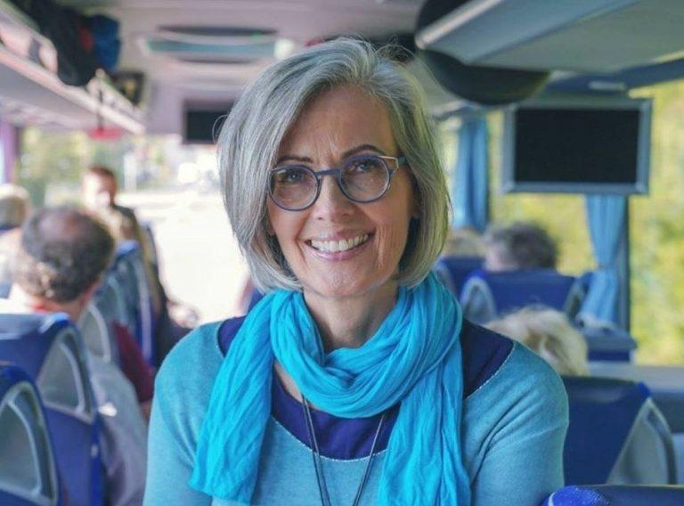 Legacy Tours owner, Kris Kimball on tour bus