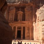 carved facade of an elaborate tomb in Petra