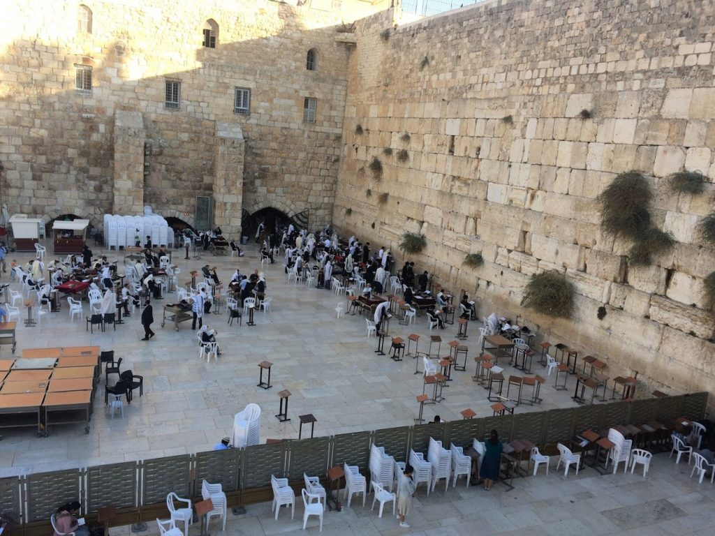 observant Jews praying at the western wall of the temple mount