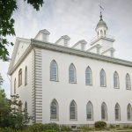 beautiful white two story church building