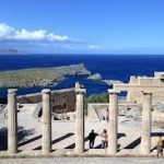 ancient colonnade of Lindos with Aegean sea in background