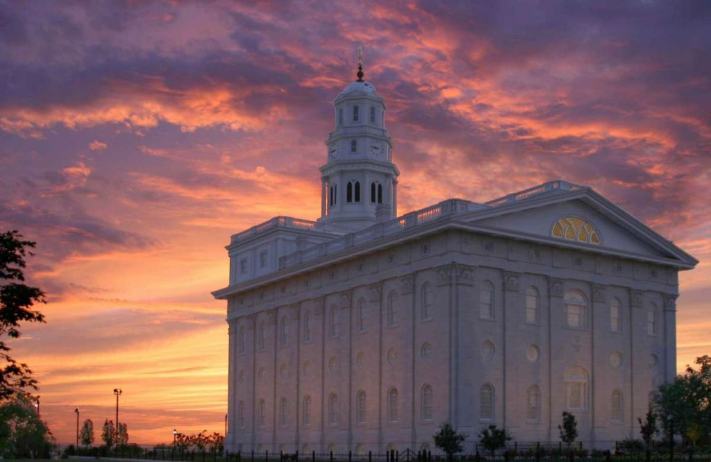 purple, pink clouds in the sky behind the Nauvoo Temple