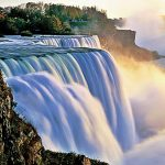 huge cascading water fall with mist