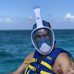 man in snorkel mask ready to snorkel in the caribbean