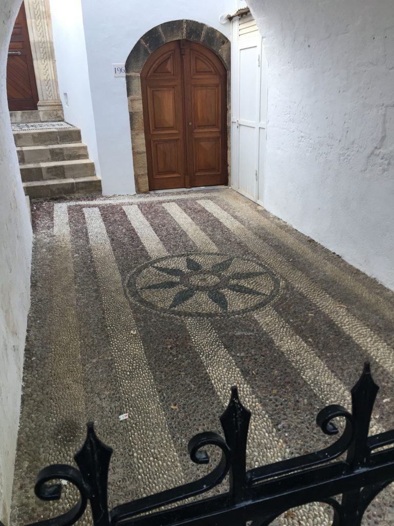 floor pattern with stripes and central star made with inlaid stones