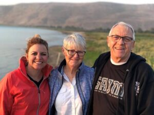 Mandy and parents on the shore of Galilee